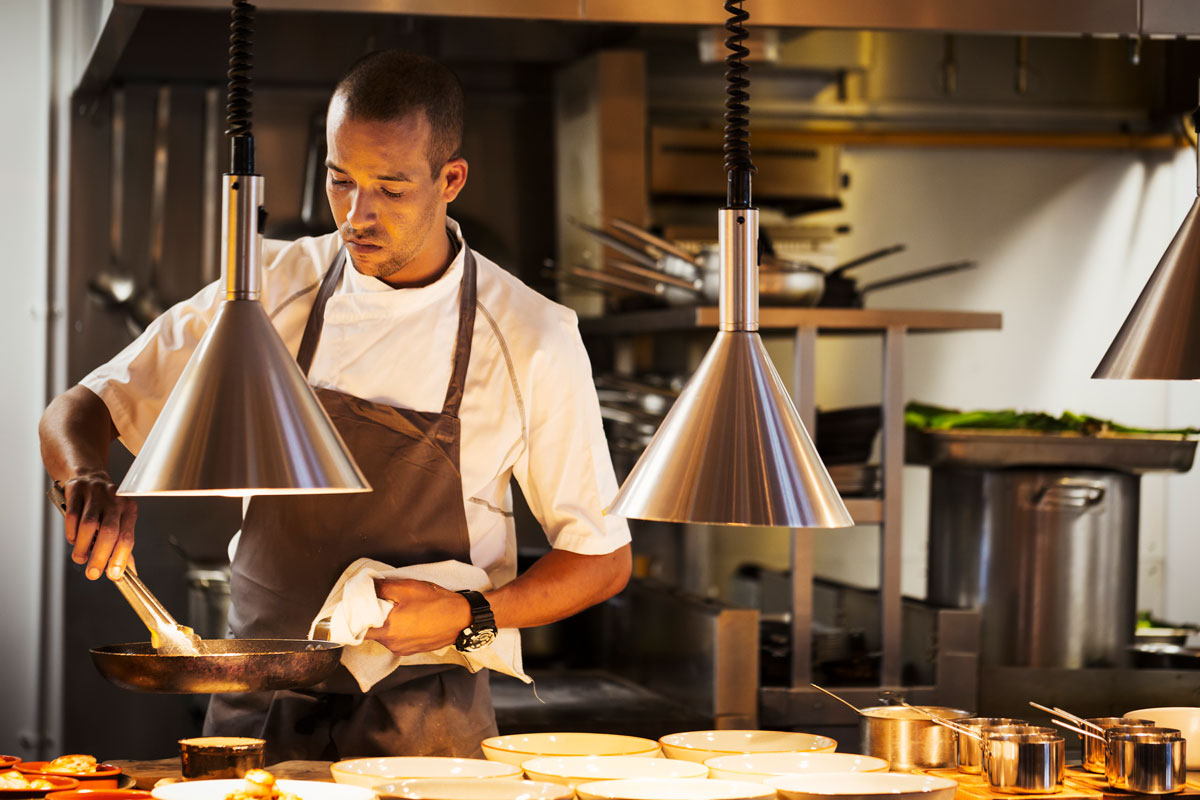 Chef working with restaurant lighting